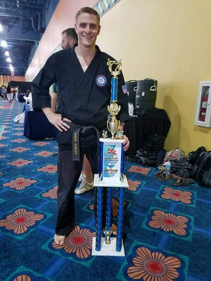 Jason Wesley with his National Champion of Self Defense trophy.