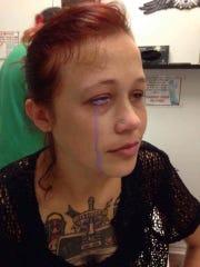 Purple ink drips down Catt Gallinger's face shortly