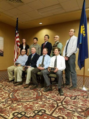 FWP fisheries crew recipients of the 2017 Governor's Award for Excellence in Helena on Monday, Sept. 25, 2017.  Front row: Leo Rosenthal, Mark Schnee, Brian Marotz, Sam Bourret. Back row: Lynda Fried, Jim Deraleau, Gov. Steve Bullock, Jon Cavigli, Matt Boyer. Not pictured are Gary Michael, Scott Relyea, Toby Tabor.