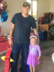 Cody Swy with his daughter Sarae, 4. On Oct. 6, 2017, Sarae found a loaded gun in the bathroom stall at Macy's.