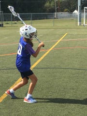 Sara Perrotta takes the ball down the field during