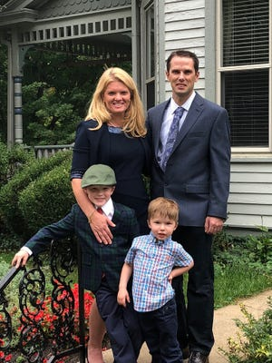 Carolyn Furdek is joined by husband Joe and children Jackson, left, and Henry.