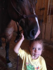 Madeline Jones with Hawk the horse