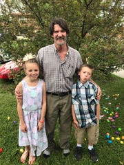 Ron Potraffke with his grandchildren.