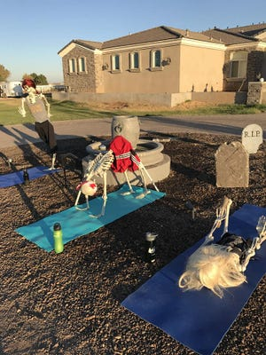Every day in October, Tyler Flake of Gilbert rearranged the skeletons he had on display in his yard - or took them on adventures - and posted pictures on Facebook. On Day 21, they did a little yoga.
