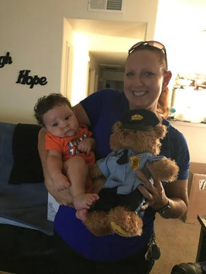 Aiden was resuscitated by Avondale police officers after he was born without a pulse on July 27, 2017. Officer Linda Karel stopped by on Nov. 2, 2017, to visit the little boy she had helped save three months earlier.