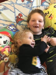 Connor Weston cuddles with his sister, Natalie.