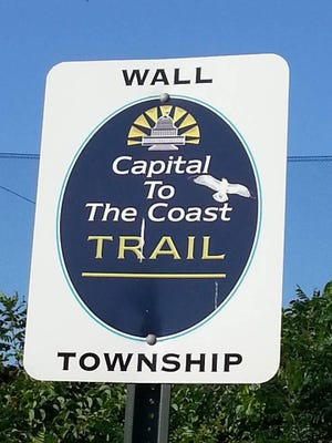 A sign for the Capital to The Coast Trail in Wall.