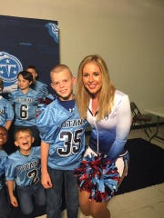 Justin Cline poses with a Tennessee Titans cheerleader.