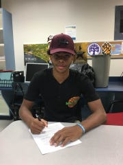 Decatur guard Kevon Voyles officially signs with the UMES men's basketball team.