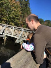 "Eric Guidry helps daughter Avery, 3, look for ""fishies"" from the fishing pier at Jimmie Davis State Park in Chatham."