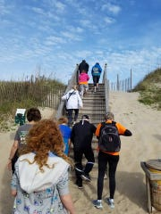 A group of hikers accompanies Jennifer Pharr Davis on the approach to the sand dunes at Jockey's Ridge State Park Nov. 18.