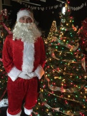 Children at the Las Cruces Festival of Trees can get a picture with Santa and his helpers.