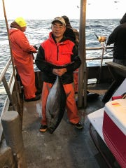 A fishermen with a bluefin tuna on the 125-foot Jamaica
