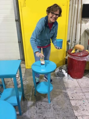 Ann Freund, Fond du Lac Morning Rotary, volunteers to help paint tables for Project TableTalk that will be on display in local businesses.