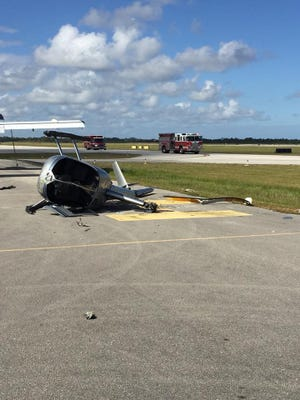 St. Lucie County Fire Rescue responds to a helicopter crash Tuesday afternoon, Dec. 5, 2017, at Treasure Coast International Airport and Business Park in St. Lucie County.