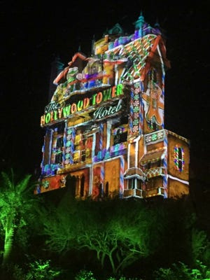 The exterior of the Tower of Terror is transformed into a gingerbread house and other jolly visions come nightfall during the holidays, part of Hollywood Studios' new Sunset Seasons Greetings offerings.