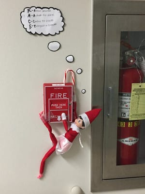 One of the four 'Elf on a Shelf' elves is photographed at the Studer Family Children's Hospital at Sacred Heart.