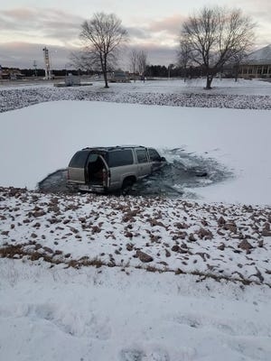 A vehicle sits in a pond following a Tuesday morning crash in Stevens Point.