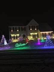 Rodney VanEiken's house in Bear is across the street from Steve Robinson's.The pair are engaged in a friendly holiday lights battle.