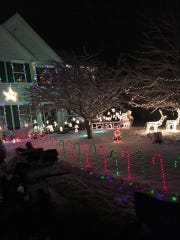 Steve Robinson's house in Bear is across the street from his friend Rodney VanEiken. The pair are engaged in a friendly holiday lights battle.