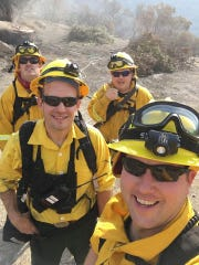 Keizer Fire engineer Mike Jensen, bottom right, engineer Matt Dryden, left front, Captain Aaron Pittis, rear left, and firefighter Bill Herring, rear right, responded to the Southern California fires along with the Marion County strike team on Tuesday, Dec. 5, 2017.