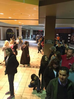 Upset patrons stand in line at the Centre of Tallahassee mall after being informed of corrupted movie files which prevented most showings of the new Star Wars film Thursday night.