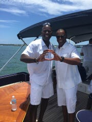 Reggie Jefferson and Willie Taggart during a fishing