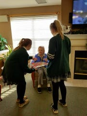 When Our Lady of Mercy Academy students visit Maurice House, there's holiday fun for everyone including eating the cookies after decorating them.