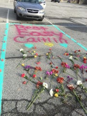 Caitlin Rouwhorst's parking spot was turned into a memorial by students.