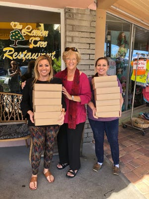 Sue Carter, center, picks up pies from The Lemon Tree.
