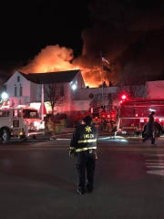 This shot from the front of American Legion Post 15 shows flames and smoke in the rear of the building. The fire early in the morning on Thursday, Dec. 28, destroyed the building at 63 E. Main St., Waynesboro.