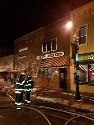 Firefighters battle a fire at Mr. G's Saloon, 136 S. Central Ave., Marshfield Christmas Eve.