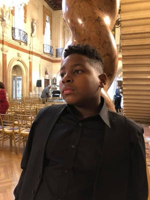 Lourde Childs, a 13-year-old from Peoria, has been playing violin since he was 6, but the Phoenix Conservatory of Music helped him find an additional instrument - his voice.