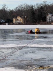 Mountain Lakes fire fighters rescue a woman who fell through the ice while skating in Mountain Lakes. Jan. 3, 2018