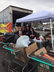 Shelton High School cheerleaders help collect donations
