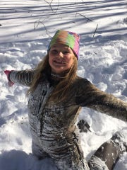 Delaney Linton plays in the snow in Belle Haven, Virginia
