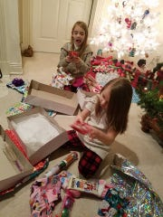 Braylynn and her sister on Christmas morning. Her condition rapidly declined in the last week.