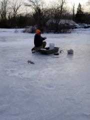 Gene Murphy, Toms River, prepares to fish in the frozen water at Colliers Mills Wildlife Management Area.