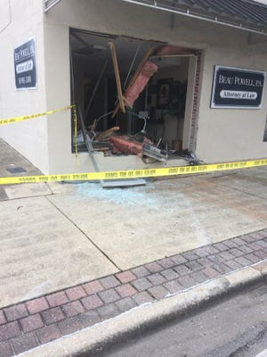 A vehicle crashed into the front entrance of the office of Beau Powell, P.A. Attorney at Law early Saturday morning on U.S. 90 in Milton.