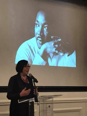 Nikki Pardo, Director of the Race Relations & Diversity Task Force, encourages the audience to develop action plans to deal with race relations at the Dr. Martin Luther King, Jr. Celebration Program at The Community House.