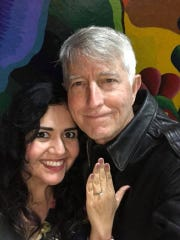 Corpus Christi muralist Sandra Gonzalez (left) and photographer Earl Parr got engaged Jan. 13, 2018 in front of the Caller-Times mural painted by Gonzalez.