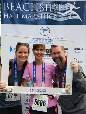 Tykes & Teens employees Brandi Cooprider, Jennifer Howell and Jeff Shearer celebrate after completing the Beachside Marathon in support of the Indian River Healthy Start Coalition.