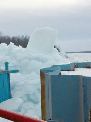 Giant piles of ice, scooped from the St. Marys River near the Sugar Island ferry docks on Sunday, Jan. 21, 2018, by island resident Eric McKerchie and his excavating crew, have helped re-establish regular ferry runs from the island to the mainland for the moment.