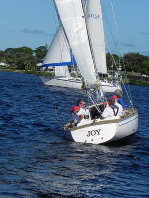Dr. Fran Clark and crew sail JOY in a Saturday race on the North Fork of the St. Lucie River.