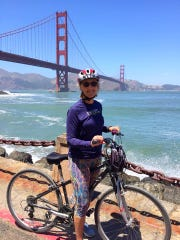 Cindy McConkey Cox, bicycling in San Franscisco in 2016 -- three years after being diagnosed with a rare, aggressive liver cancer.