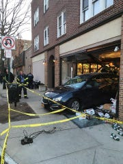 A car crashed into the storefront of DeCicco Food Market in Pelham on Thursday, Jan. 25, 2018.