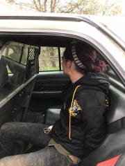 Marlena Hines, 32, of Oregon is show in the back of a Redding Police patrol car following her arrest.