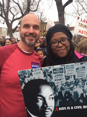 Deborah Burstion, a longtime Cincinnati activist for civil rights and sexual health, died Jan. 13, 2018. In 2017, she marched with longtime friend Andy Ruffner in the women's march in Cincinnati.