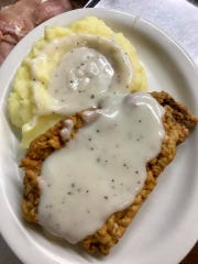 Country fried steak with mashed potatoes is a Southern